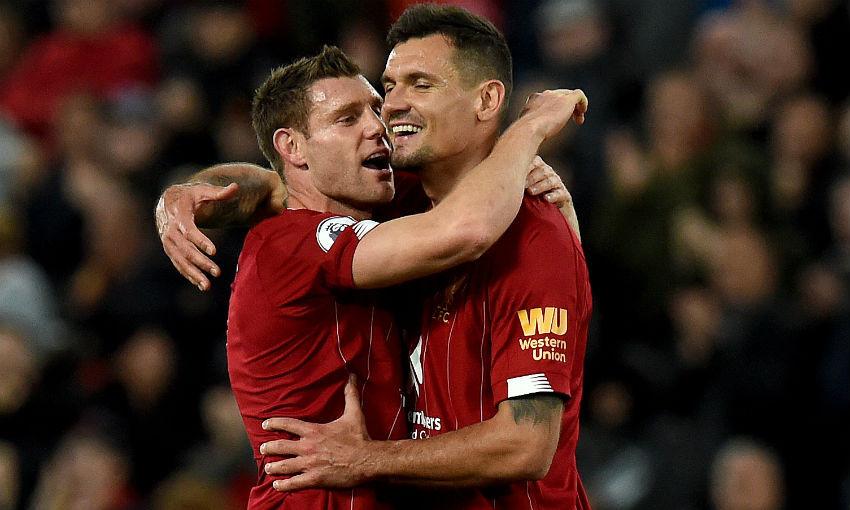 Dejan Lovren and James Milner of Liverpool FC