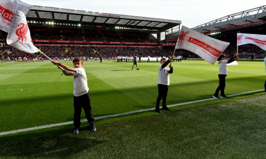 Flag bearers before the friendly match between Liverpool FC Legends and AC Milan Glorie at Anfield on March 23, 2019 in Liverpool, England.