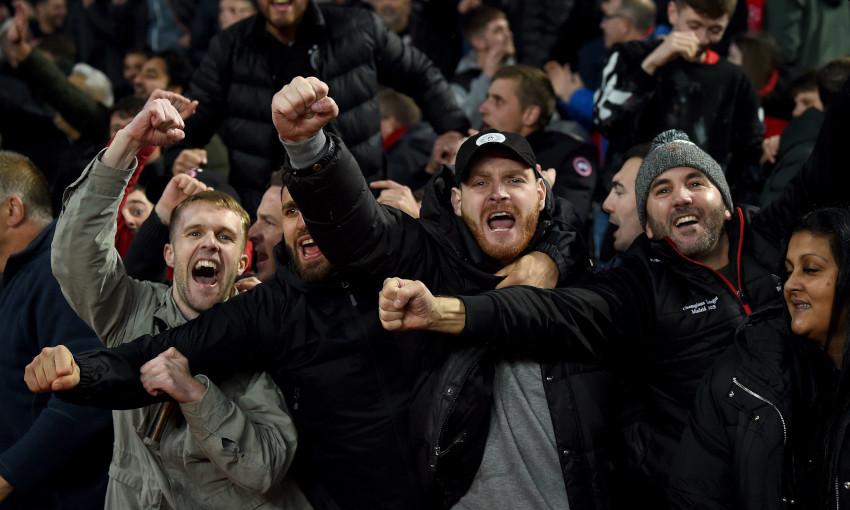 Liverpool fans celebrate at Villa Park