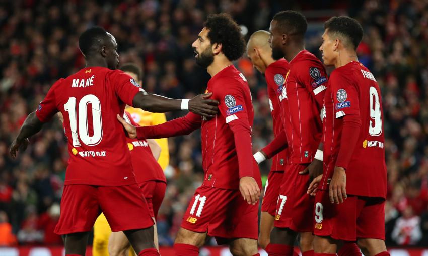Sadio Mane celebrates with Mohamed Salah