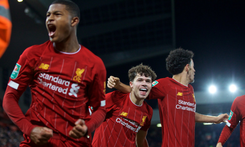 Neco Williams celebrates on his debut at Anfield