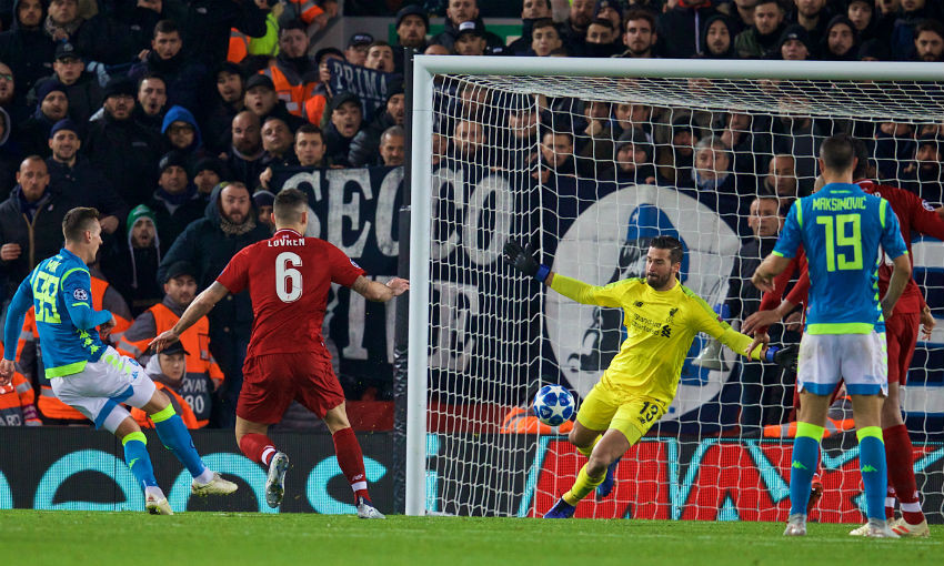 Liverpool's goalkeeper Alisson Becker makes an injury time save from Napoli's Arkadiusz Milik during the UEFA Champions League Group C match between Liverpool FC and SSC Napoli at Anfield.