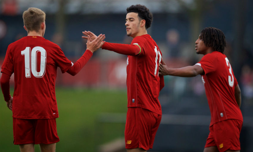 Liverpool's captain Curtis Jones (C) celebrates scoring the second goal from a penalty kick during the UEFA Youth League Group E match between Liverpool FC Under-19's and SSC Napoli Under-19's at the Liverpool Academy.