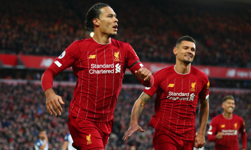 Virgil van Dijk celebrates scoring against Brighton