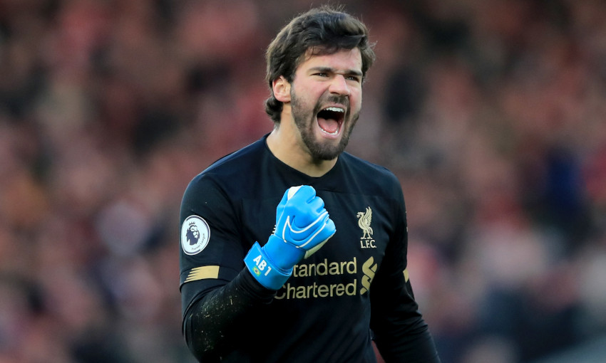 Alisson Becker celebrates