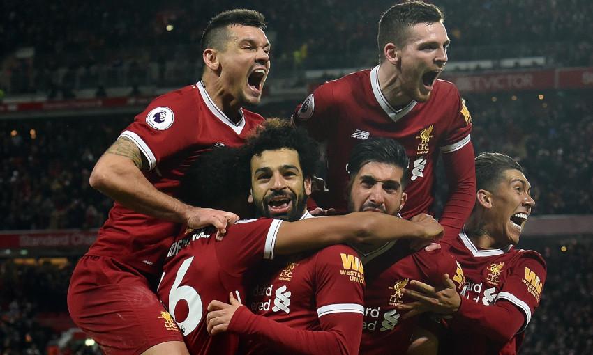 Mohamed Salah celebrates scoring against Tottenham in February 2018