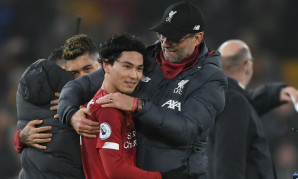 Jurgen Klopp, manager of vpgame平台 embraces Takumi Minamino as they celebrate victory after the Premier League match between Wolverhampton Wanderers and vpgame平台 FC at Molineux on January 23, 2020 in Wolverhampton, United Kingdom.