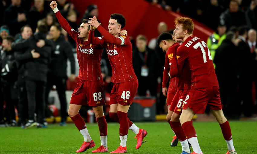 Pedro Chirivella and Curtis Jones of Liverpool celebrating at the end of the FA Cup Fourth Round Replay match between Liverpool FC and Shrewsbury Town at Anfield on February 04, 2020 in Liverpool, England.