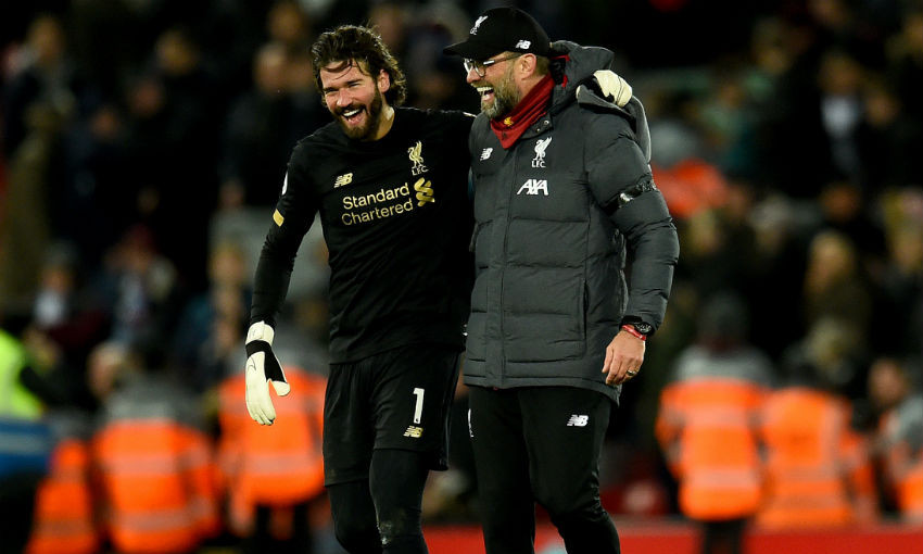 Jurgen Klopp manager of Liverpool with Alisson Becker of Liverpool the Premier League match between Liverpool FC and West Ham United at Anfield on February 24, 2020 in Liverpool, United Kingdom.