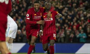 Gini Wijnaldum and Sadio Mane of Liverpool FC celebrate a goal against West Ham United