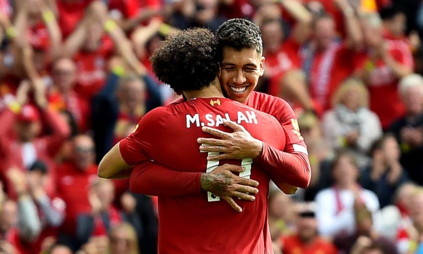 Mohamed Salah and Roberto Firmino celebrate