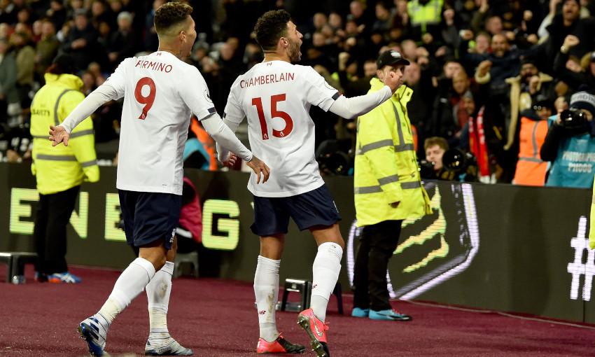 Alex Oxlade-Chamberlain celebrates a goal at West Ham United