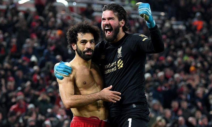Mohamed Salah and Alisson Becker celebrate