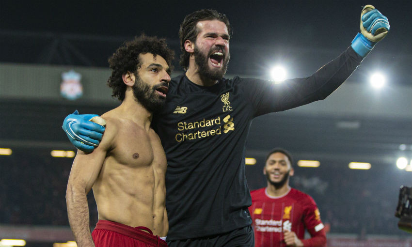 Mohamed Salah and Alisson Becker of Liverpool FC