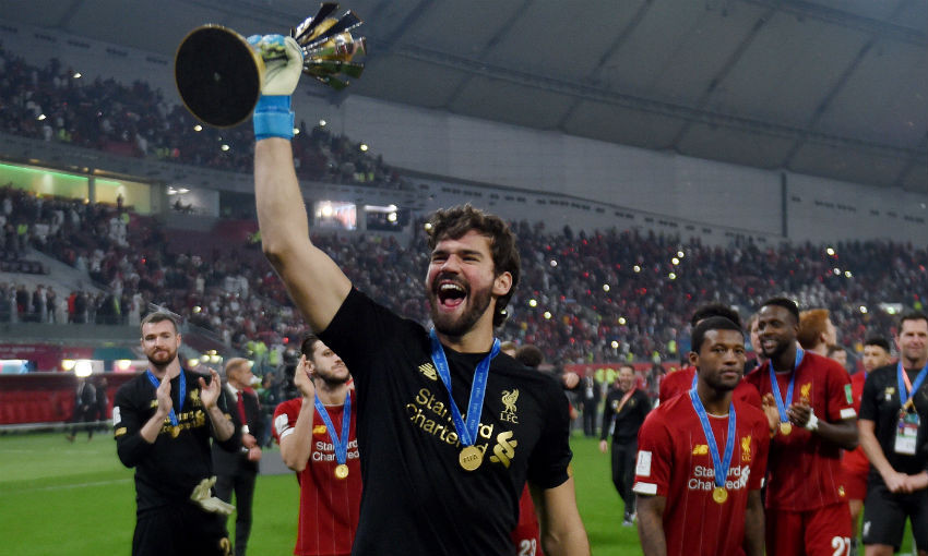 Alisson Becker of Liverpool FC with FIFA Club World Cup trophy