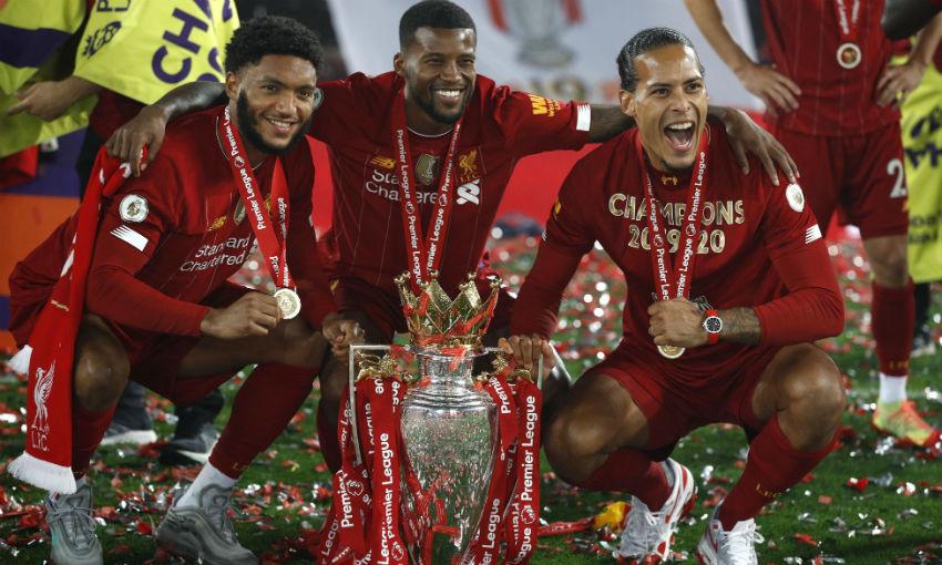 Virgil van Dijk of Liverpool FC with Premier League trophy