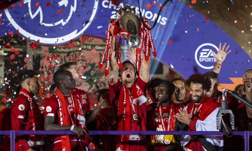 Dejan Lovren lifts the Premier League trophy