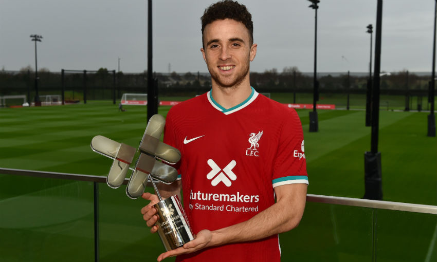 Diogo Jota with Liverpool FC Standard Chartered Player of the Month trophy