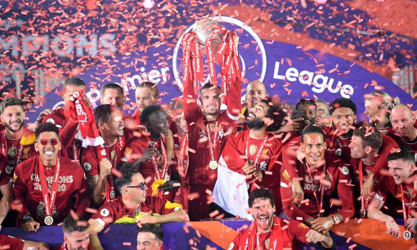 Jordan Henderson lifts the 2019-20 Premier League trophy