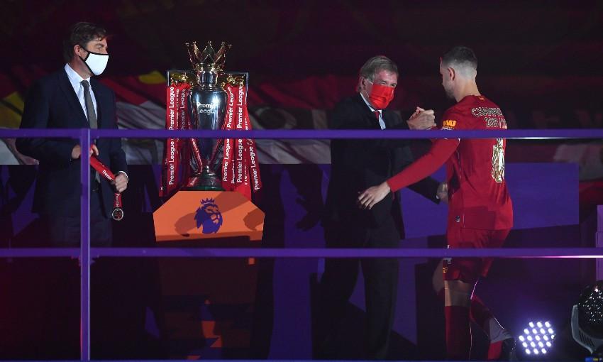 Sir Kenny Dalglish and Jordan Henderson of Liverpool FC