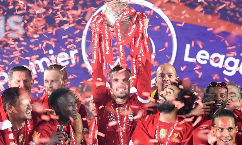 Jordan Henderson of Liverpool FC with Premier League trophy