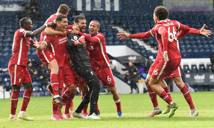 Alisson Becker celebrates scoring against West Bromwich Albion