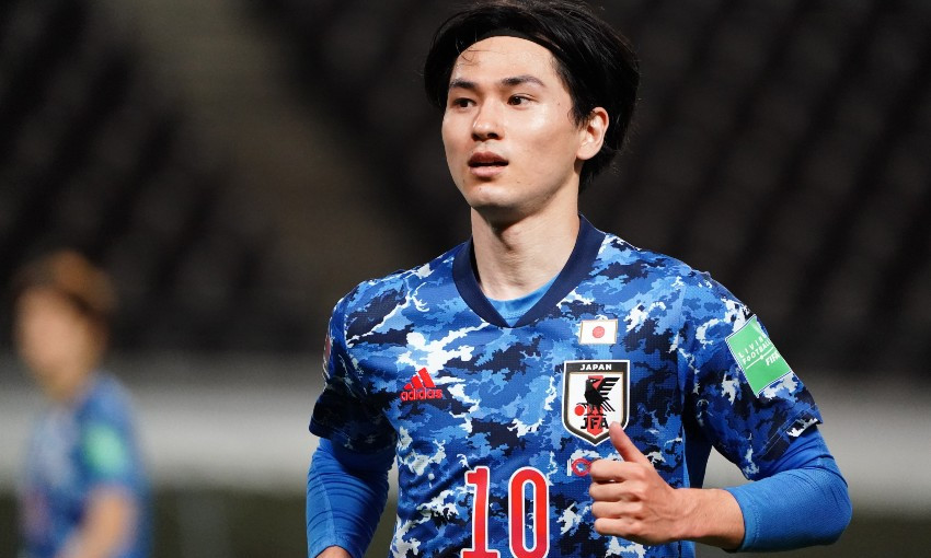 Takumi Minamino of Liverpool FC in action for Japan