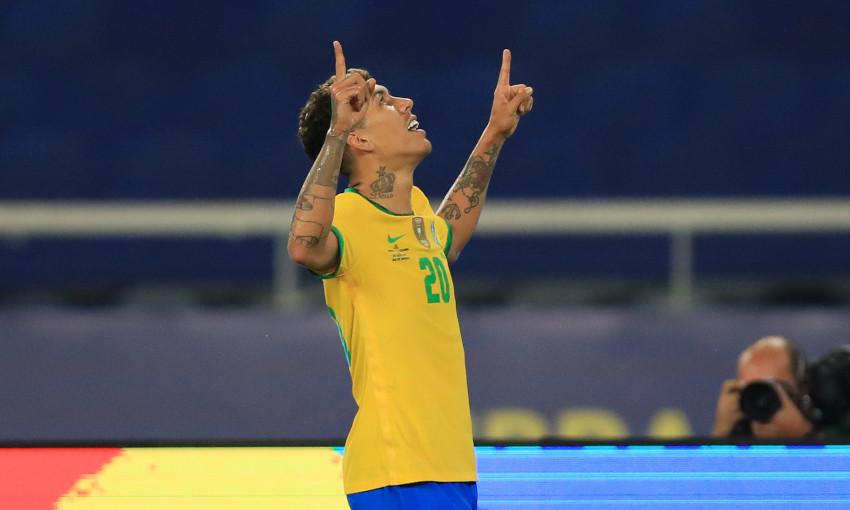 Roberto Firmino celebrates scoring for Brazil