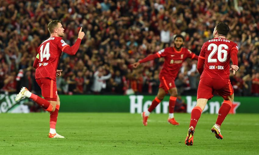 Jordan Henderson celebrates scoring against AC Milan