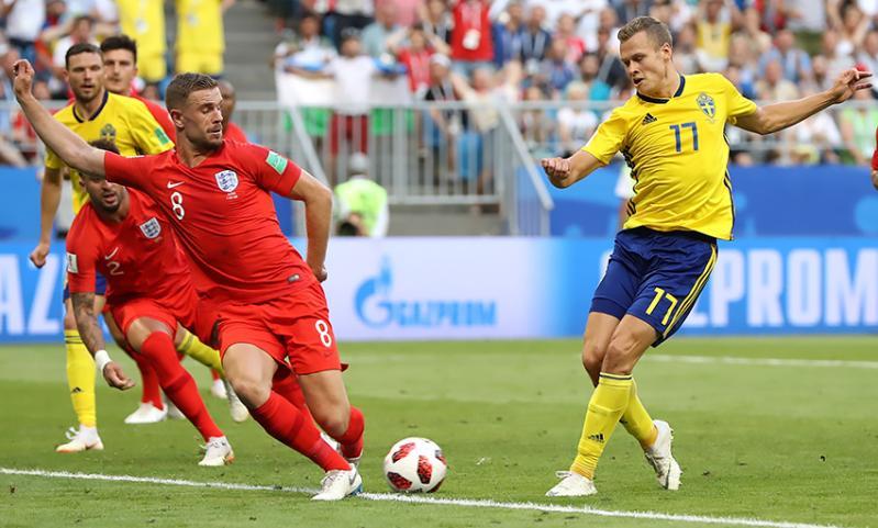 England's Jordan Henderson blocks a shot from Viktor Claesson of Sweden.