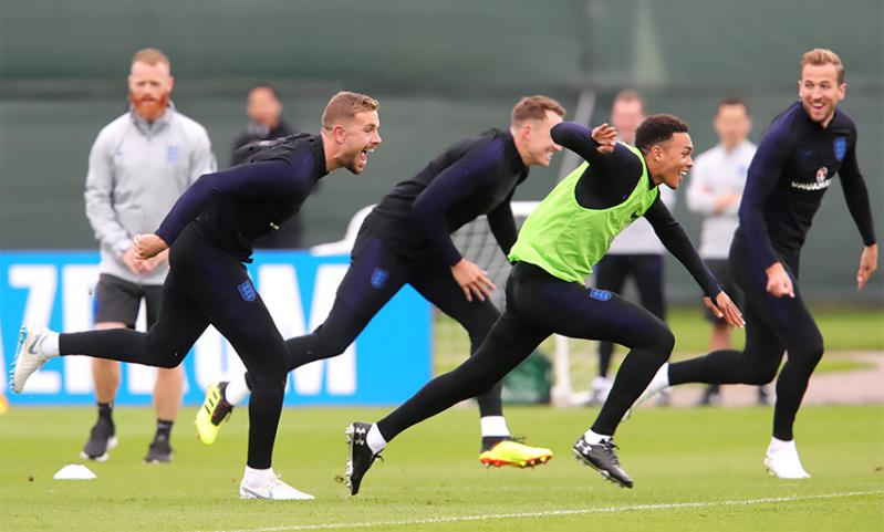 Jordan Henderson chases Liverpool teammate Trent Alexander-Arnold during England training.