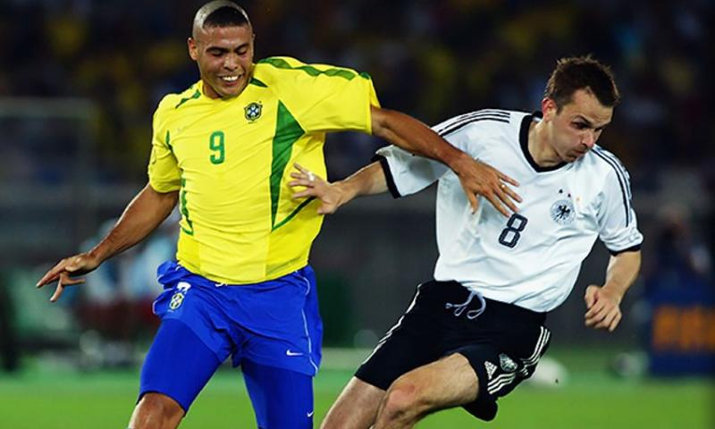 Liverpool and Germany midfielder battles with Brazil striker Ronaldo during the 2002 World Cup final.