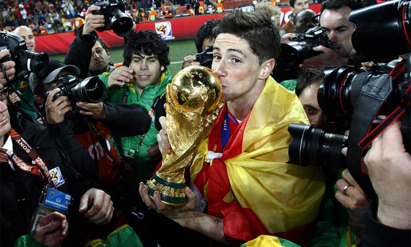 Liverpool and Spain striker Fernando Torres kisses the World Cup after beating Netherlands in the 2010 final.