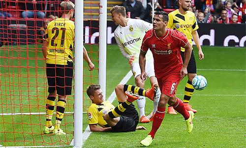 Liverpool's Dejan Lovren scores against Borussia Dortmund at Anfield.