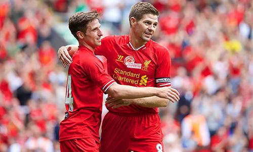 Liverpool captain Steven Gerrard congratulates goalscorer Joe Allen against Olimpiacos