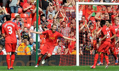 Liverpool's Lucas Leiva celebrates scoring against Bayer Leverkusen at Anfield.