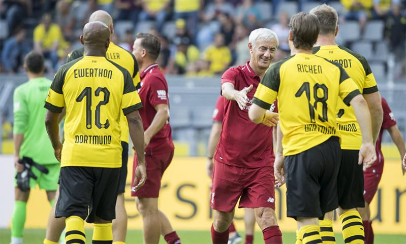 Liverpool Legends player-manager Ian Rush shakes hands with the BVB Legends